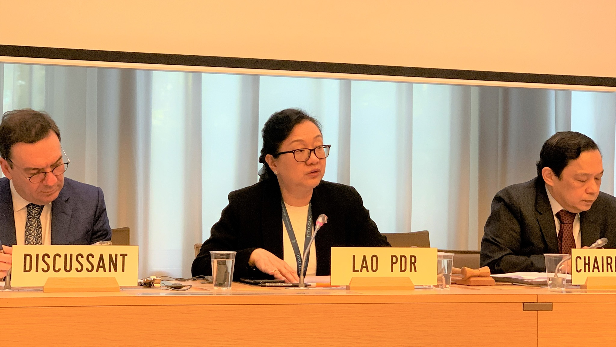 The opening statement delivered by H.E. Mrs. Khemmani Pholsena, Minister of Industry and Commerce of Lao PDR. On her right: H.E. Mr. Jean-Marie Paugman, Permanent Representative of France to the WTO, the Discussant. On her left: H.E. Mr. Manuel A.J. Teehankee, Ambassador, Permanent Representative of Philippines to the WTO, the Chairperson.