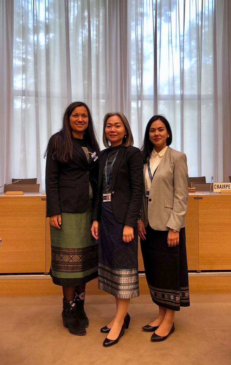 The part of the preparation team wearing the Lao national  attire: Dr. Leonila Guglya, Policy Adviser, IDEAS Centre, Ms. Vilayphone Xindavong, Director of Multilateral Trade Division, Department of Foreign Trade Policy, MOIC, Lao PDR; Ms. Souvipha Inthavong, Deputy Director of Multilateral Trade Division, Department of Foreign Trade Policy, MOIC, Lao PDR.